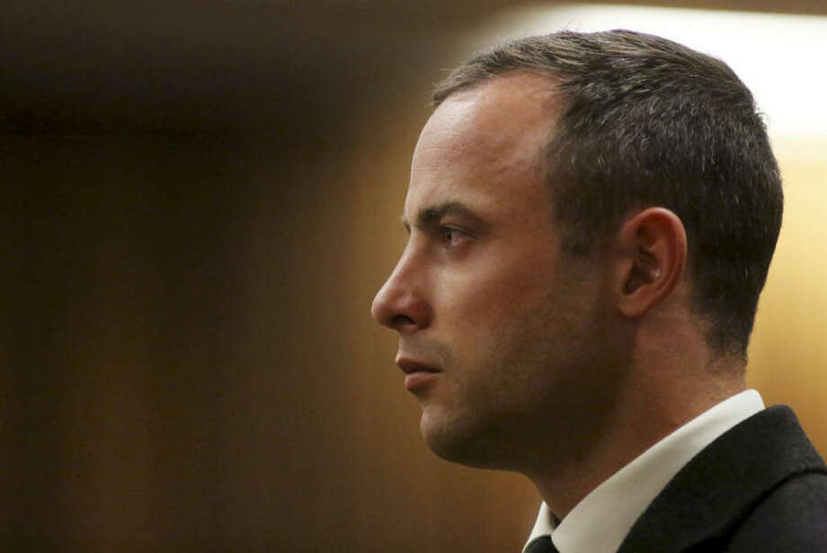 Oscar Pistorius, listens as a court ruling is handed down that he would undergo psychiatric evaluation in Pretoria, South Africa, Tuesday, May 20, 2014. Pistorius is charged with the shooting death of his girlfriend Reeva Steenkamp on Valentine's Day in 2013. (AP Photo/Siphiwe Sibeko, Pool)