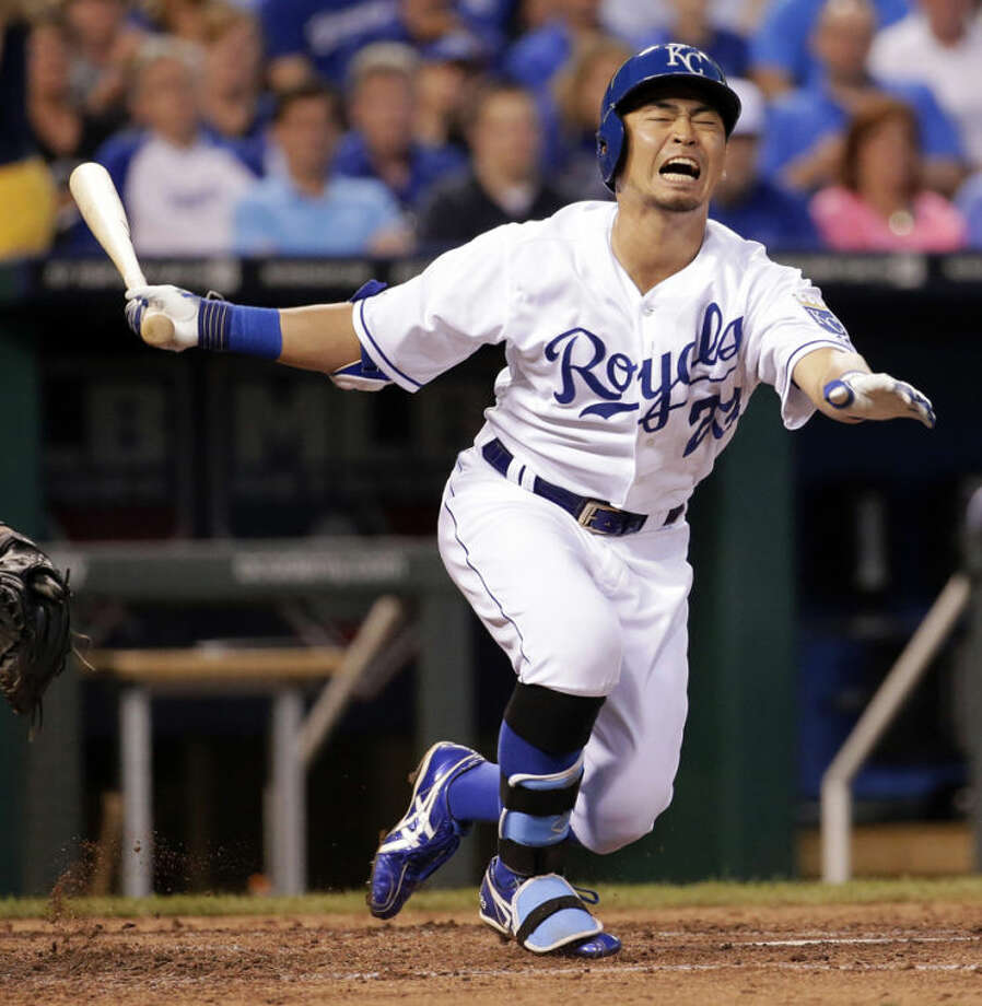 Kansas City Royals' Norichika Aoki, of Japan, reacts after hitting a foul ball off his leg during the fourth inning of a baseball game against the Chicago White Sox on Monday, May 19, 2014, in Kansas City, Mo. (AP Photo/Charlie Riedel)