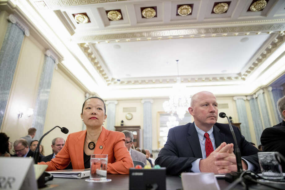 """National Transportation Safety Board (NTSB) Vice Chairman Tho """"Bella"""" Dinh-Zarr, left, and Amtrak Executive Vice President and Chief Operations Officer D.J. Stadtler, sit on Capitol Hill in Washington, Wednesday, June 10, 2015, prior to testifying before the Senate Commerce, Science and Transportation hearing to examine passenger rail safety, focusing on accident prevention and on-going efforts to implement train control technology. (AP Photo/Andrew Harnik)"""