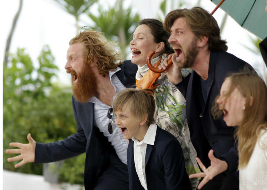 From left, actor Kristofer Hivju, actor Vincent Wettergren, actress Lisa Loven Kongsli, director Ruben Ostlund, and actress Clara Wettergren pose for photographers during a photo call for Turist at the 67th international film festival, Cannes, southern France, Monday, May 19, 2014. (AP Photo/Thibault Camus)