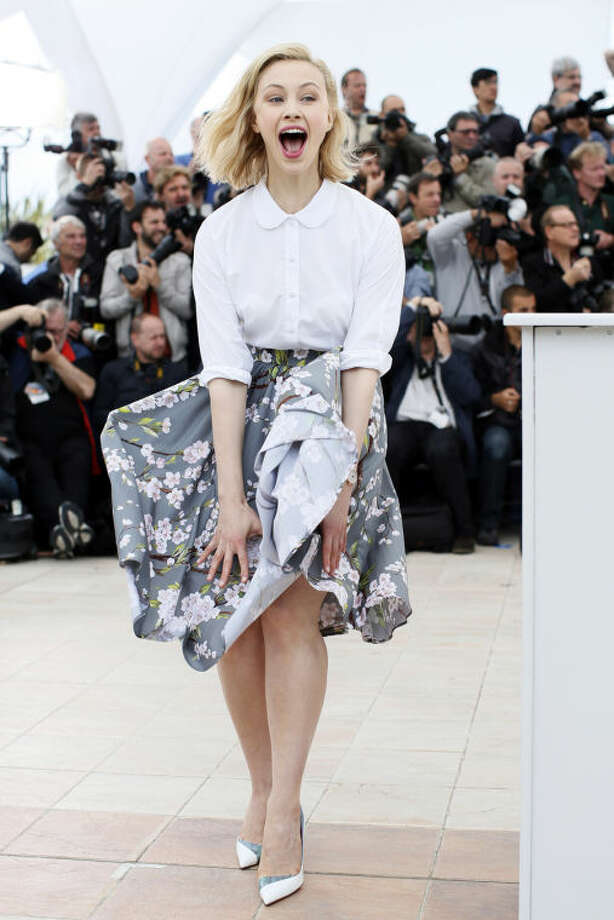 Actress Sarah Gadon reacts as her skirt is blown by the wind as she poses for photographers during a photo call for Maps to the Stars at the 67th international film festival, Cannes, southern France, Monday, May 19, 2014. (AP Photo/Alastair Grant)