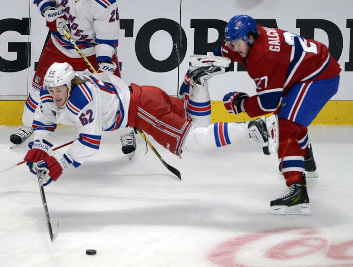 New York Rangers left wing Carl Hagelin (62) is tripped by Montreal Canadiens center Alex Galchenyuk (27) during the second period in Game 2 of the NHL hockey Eastern Conference final Stanley Cup playoff series Monday, May 19, 2014, in Montreal. (AP Photo/The Canadian Press, Ryan Remiorz)