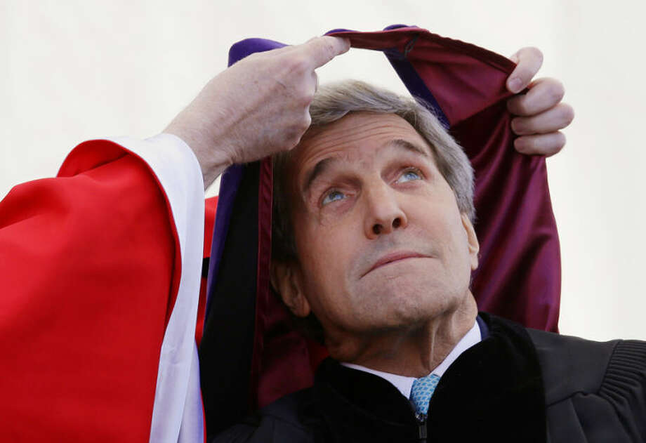 Secretary of State John Kerry his hooded by Boston College President William Leahy during the Boston College commencement ceremony, Monday, May 19, 2014, in Boston. Kerry received an honorary Ph. D. before giving the college's 2014 commence address. (AP Photo/Stephan Savoia)