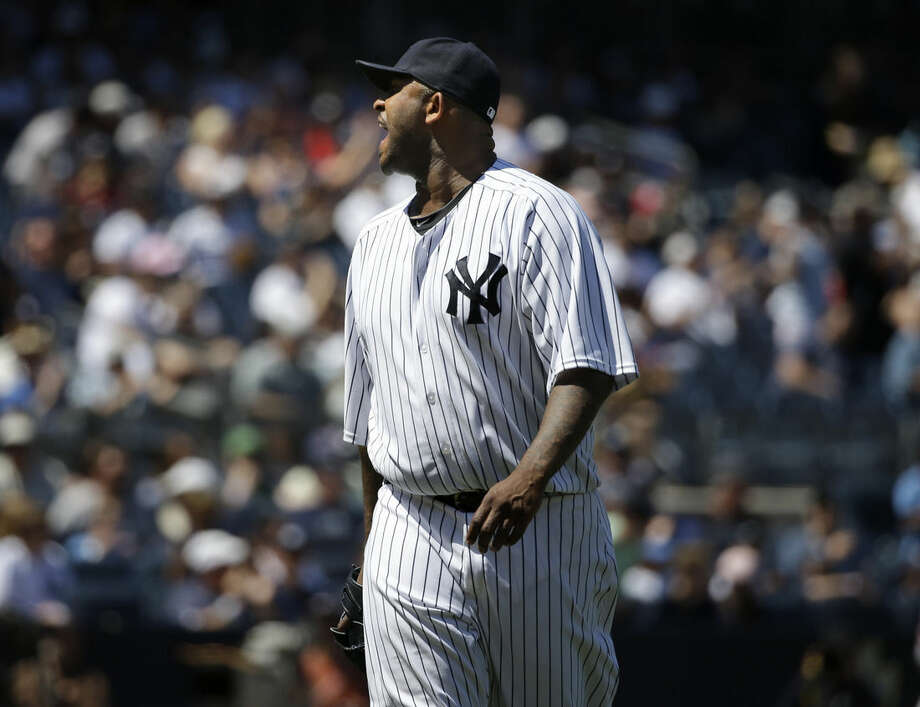 New York Yankees starting pitcher CC Sabathia yells at the home plate umpire during the sixth inning of a baseball game against the Los Angeles Angels, Sunday, June 7, 2015, in New York. Sabathia and manager Joe Girardi were ejected from the game. (AP Photo/Seth Wenig)