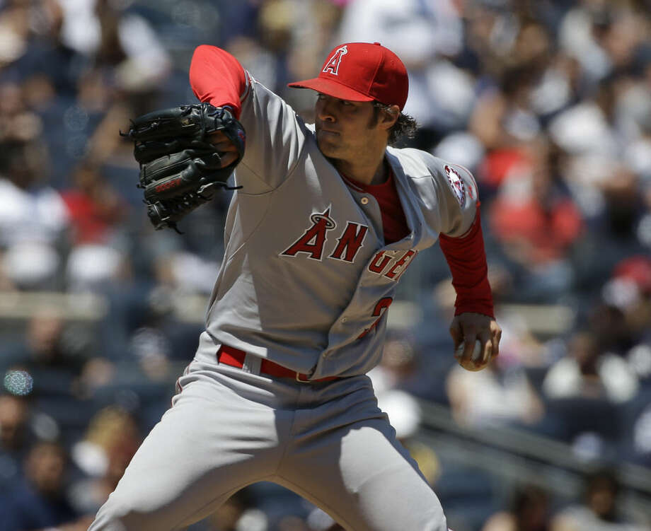 Los Angeles Angels starting pitcher C.J. Wilson throws during the third inning of a baseball game Sunday, June 7, 2015, in New York. (AP Photo/Seth Wenig)