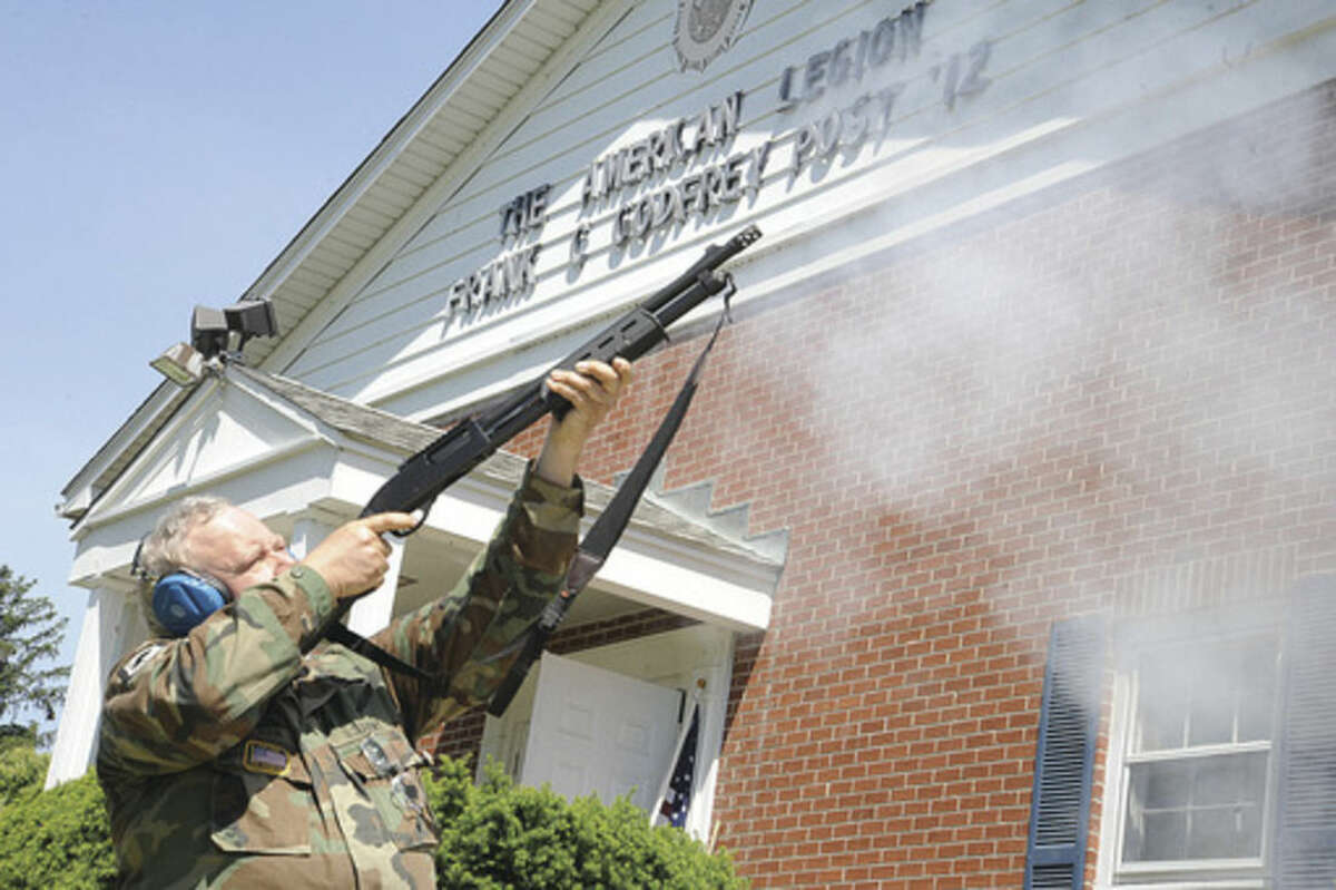 Rich Olson: Senior Vice Commander American Legion Post 12 in Norwalk fires three shots at the ceremony Sunday to honor Veteran of the Month Army Veteran Carl Peter Gallo. Hour photo/Matthew Vinci