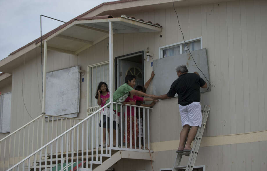 A man puts boards up the windows of his house in preparation for Hurricane Blanca, in Cabo San Lucas, Mexico, Sunday June 7, 2015.The unpredictable storm strengthened rapidly to a Category 4 storm on Saturday, but the U.S. National Hurricane Center says it has since weakened to Category 1 with top winds near 90 mph. (AP Photo/Eduardo Verdugo)