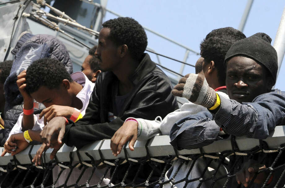 Migrants wait to disembark from the German Navy ship Hessen at the Palermo harbor, Italy, Sunday, June 7, 2015. European rescue boats are bringing thousands of migrants saved at sea to Italian ports, prompting center-right politicians to vow that their regions won't shelter any more of them. (AP Photo/Alessandro Fucarini)