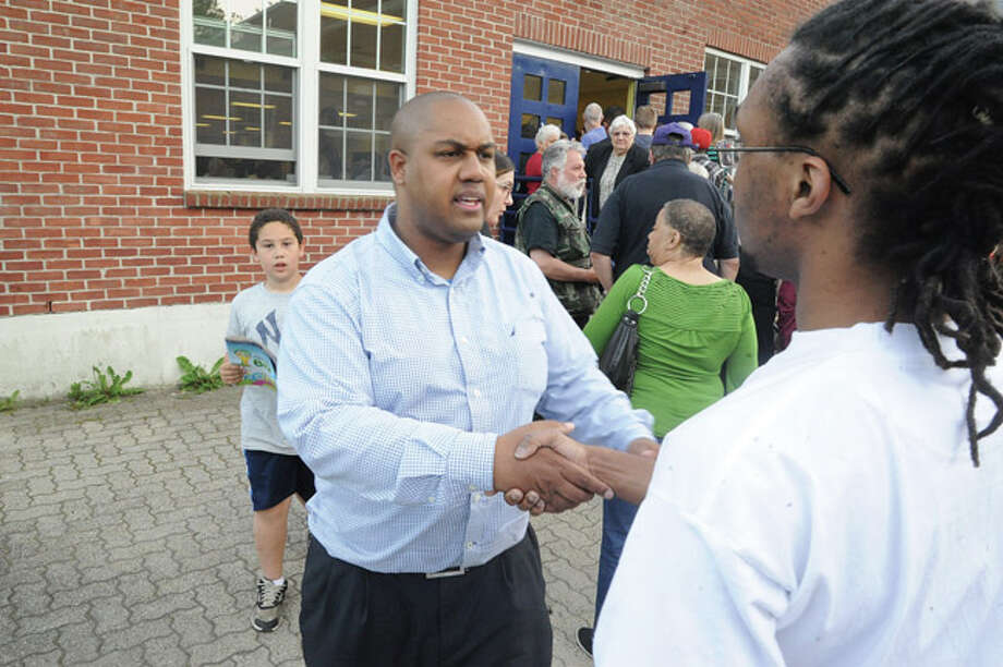 David A. Watts greets voters at Tracey Elementary School on Tuesday where democrats held a caucas for the 137th District seat for the state House of Representatives. Hour photo/Matthew Vinci