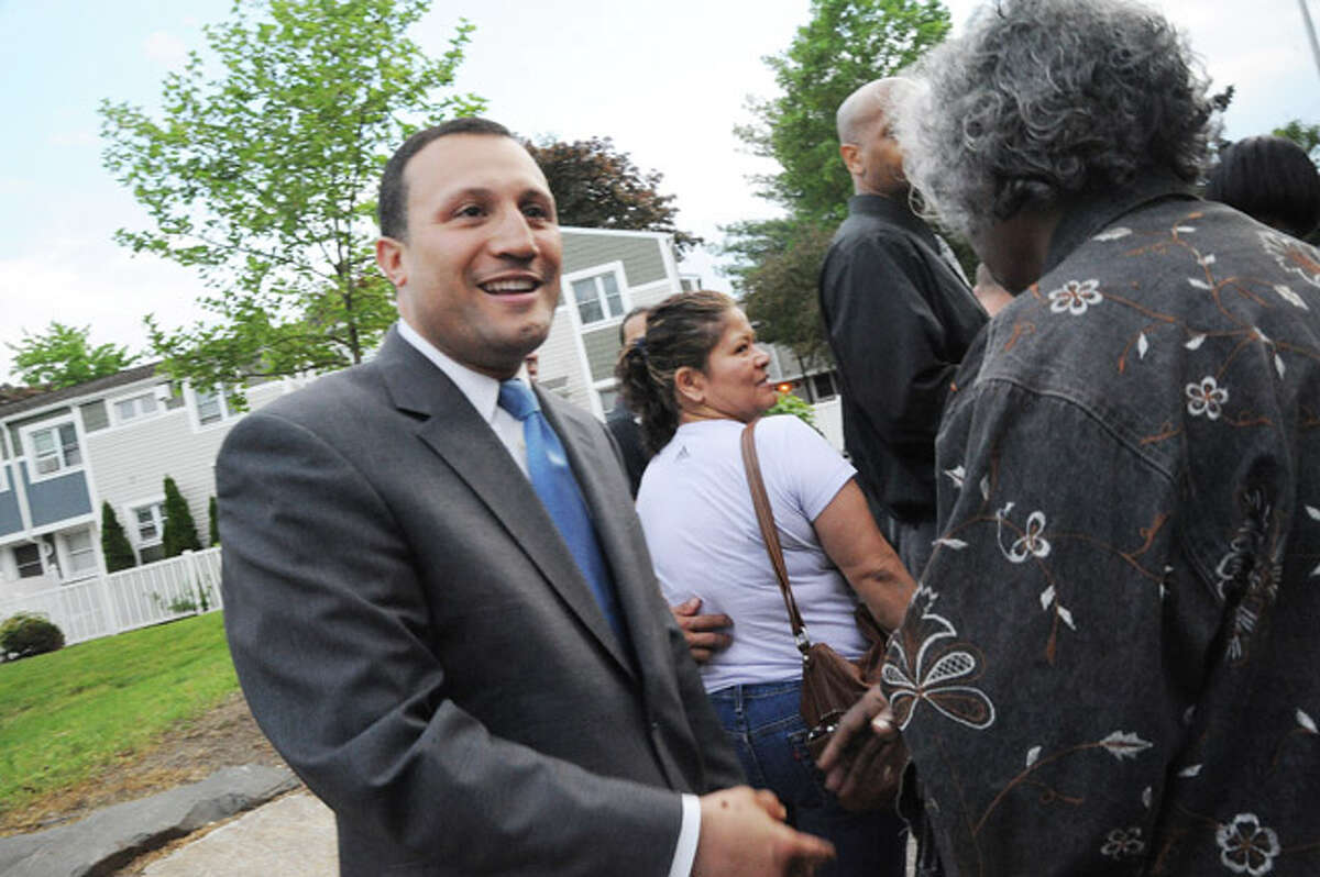 Warren A. Pena greets voters Tuesday at Columbus School in Norwalk where he is running for the 140th District seat in the state House of Representatives. Hour photo/Matthew Vinci