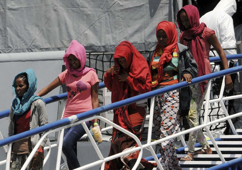 Migrants disembark from the German Navy ship Hessen at the Palermo harbor, Italy, Sunday, June 7, 2015. European rescue boats are bringing thousands of migrants saved at sea to Italian ports, prompting center-right politicians to vow that their regions won't shelter any more of them. (AP Photo/Alessandro Fucarini)