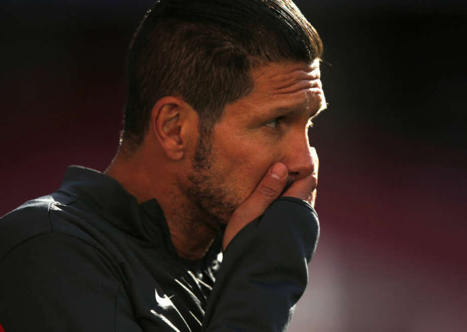 Atletico's coach Diego Simeone gestures, during a training session ahead of Saturday's Champions League final soccer match between Real Madrid and Atletico Madrid, in Luz stadium in Lisbon, Portugal, Friday, May 23, 2014. (AP Photo/Daniel Ochoa de Olza)