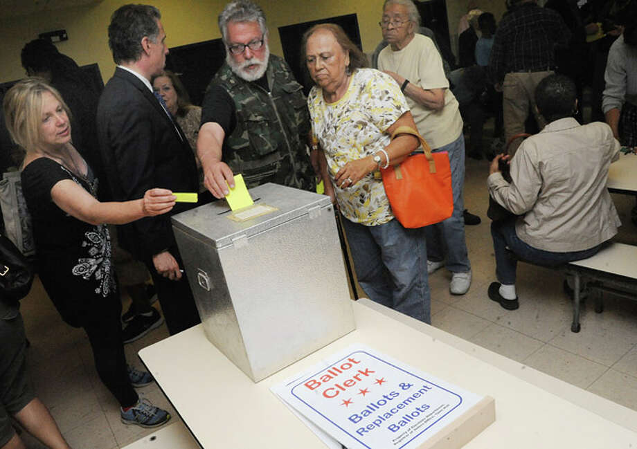 Voters casting ballots Tuesday at Tracey School for the 137th District seat of the state House of Representatives. Hour photo/Matthew Vinci