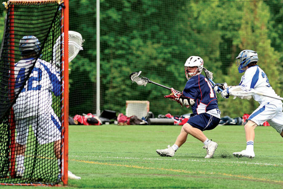 Hour photo / Erik Trautmann Brien McMahon's #14 james Campbell looks for room to shoot against Darien in their FCIAC game Friday