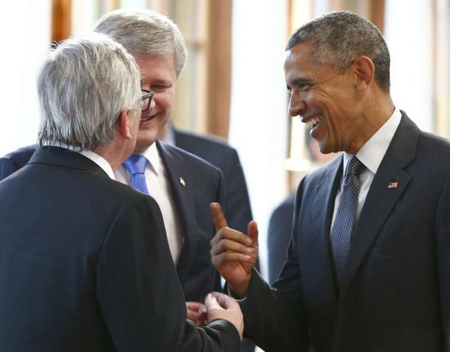 Canada's Prime Minister Stephen Harper and European Commission President Jean-Claude Juncker, left, greet U.S. President Barack Obama, right, before a working meeting at the G-7 summit at Schloss Elmau hotel near Garmisch-Partenkirchen, southern Germany, Monday, June 8, 2015. (Michaela Rehle/Pool Photo via AP)