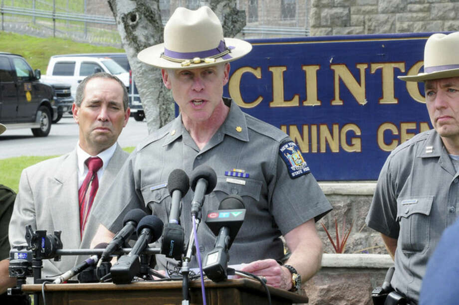 Charles Guest of the New York State Police speaks during a news conference as law enforcement officers search for two escaped prisoners Sunday, June 7, 2015, in Dannemora, N.Y. The two murderers who used power tools to escape from prison must have taken days to cut through steel walls and pipes and break through the bricks at the maximum-security prison, New York Gov. Andrew Cuomo said Sunday. (Rob Fountain/The Press-Republican via AP)