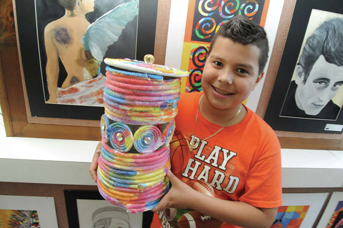 """Kendall Elemenatry School 5th grader Harold Vienna with his """"Cord Vessel"""" made of cording, watercolor and gems Tuesday in the Norwalk City Hall community room for the Norwalk Public Schools Citywide Art Show opening ceremony. Hour photo/Matthew Vinci"""