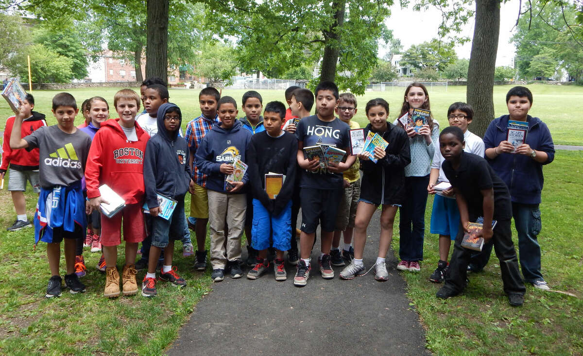 Students received free books at the Reading is FUNdamental Book Give-A-Way.