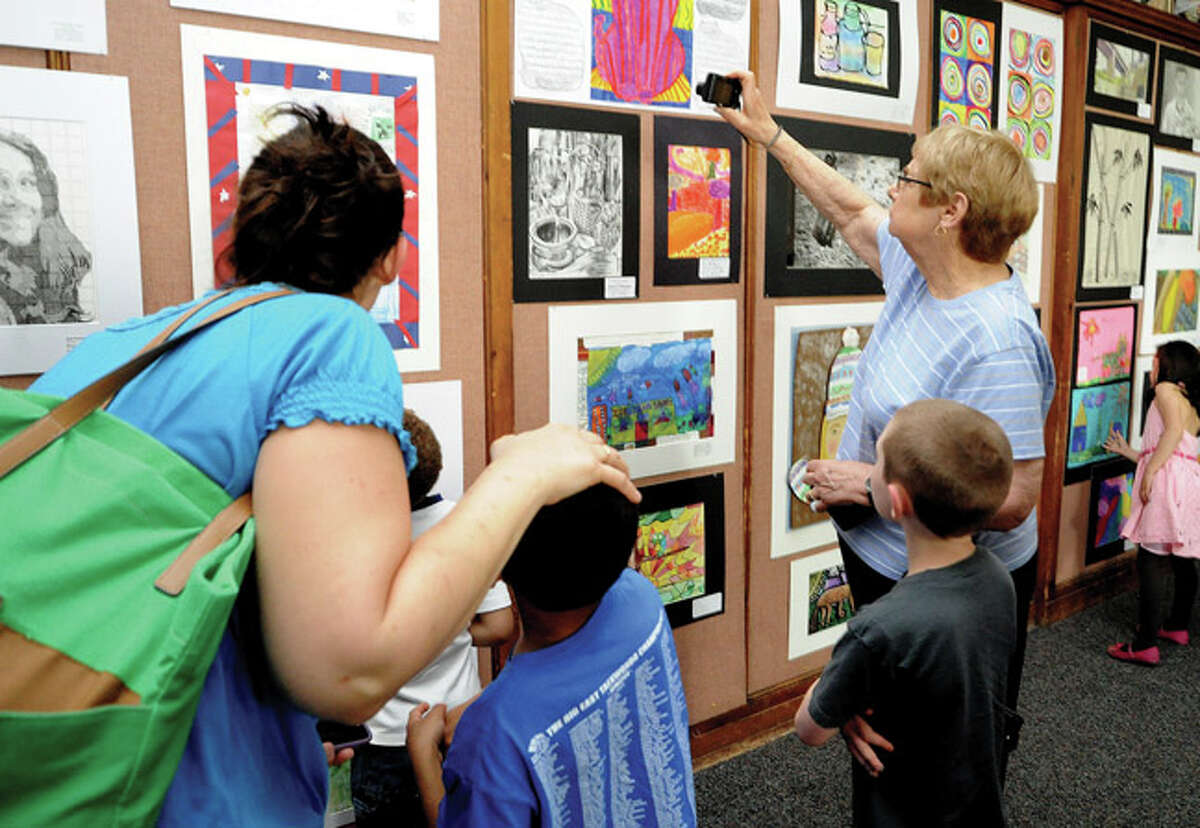 Families and friends look at work Tuesday in the Norwalk City Hall community room for the Norwalk Public Schools Citywide Art Show opening ceremony. Hour photo/Matthew Vinci