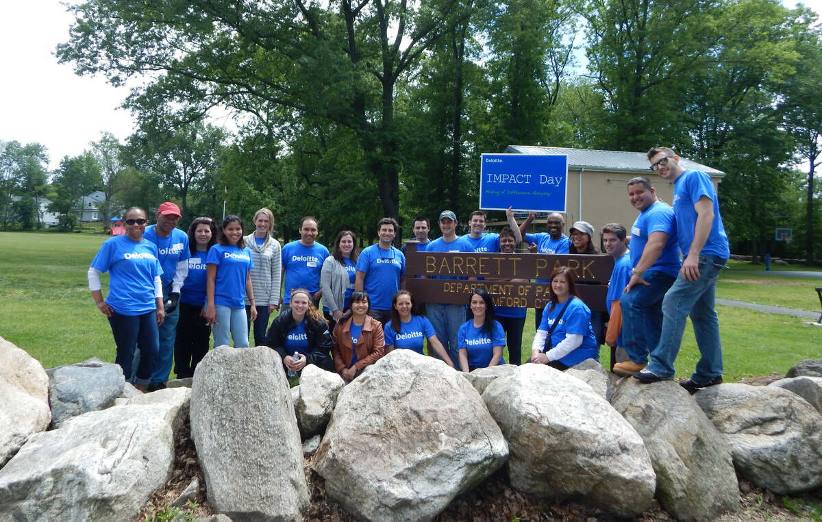 Deloitte employees participate in Impact Day, a full day of community volunteerism, in which they helped make improvements to Stamford's Barrett Park.