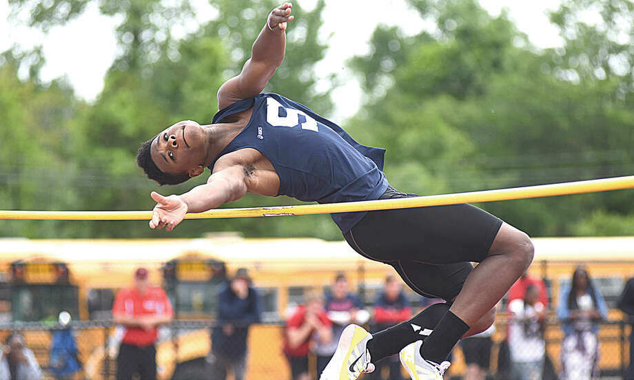 Hour photo/John Nash - Anthony Bravo of Staples won the State Open high jump championship on Monday at Willbow Brook Park in New Britain on Monday. Bravo also won the long jump.