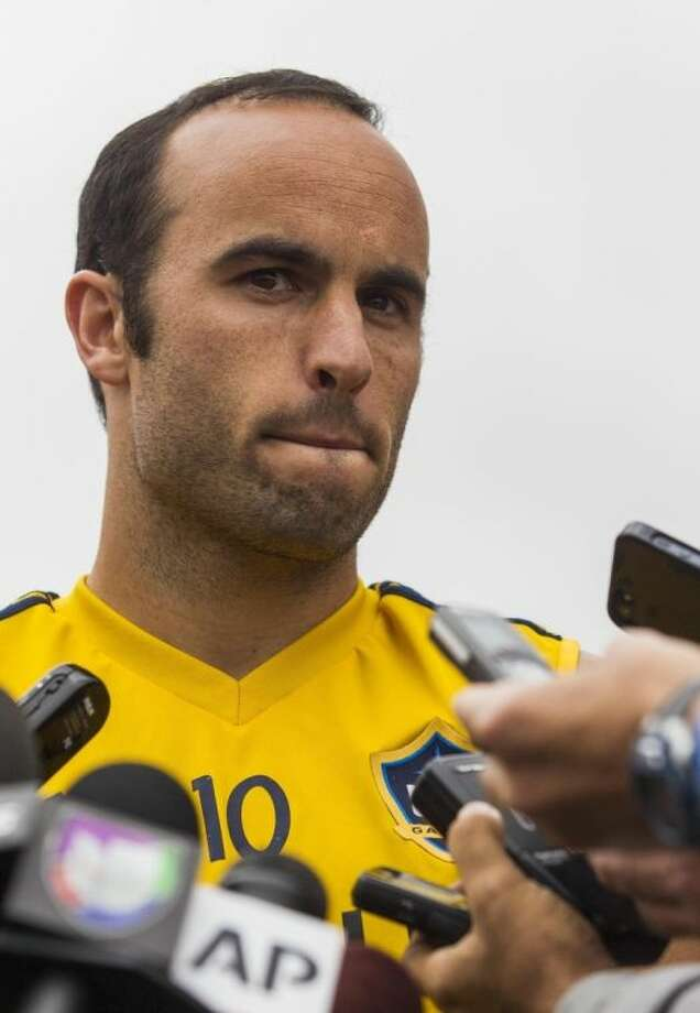 Los Angeles Galaxy forward Landon Donovan talks to media after a soccer training session at StubHub Center in Carson, Calif., Saturday, May 24, 2014. Donovan, the most accomplished American player in the history of men's soccer, won't be going to his fourth World Cup. The 32-year-old attacker was among seven players cut Thursday when coach Jurgen Klinsmann got down to the 23-man limit well before the June 2 deadline. (AP Photo/Ringo H.W. Chiu)