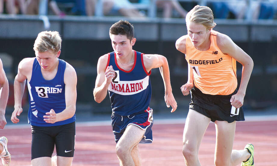 Hour photo/John Nash - Brien McMahon's Eric van der Els, center, breaks from the start of the third heat of the boys 3,200-meter run along with Darien's Armstrong Noonan, left, and Ridgefield's Austin Gilbert. Van der Els won the event in 9:23.94.