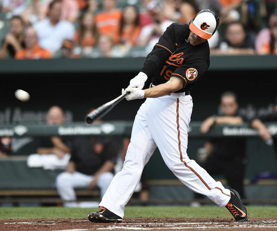 Baltimore Orioles' Chris Davis follows through on an RBI-single against the New York Yankees in the first inning of a baseball game Friday, June 12, 2015, in Baltimore. (AP Photo/Gail Burton)