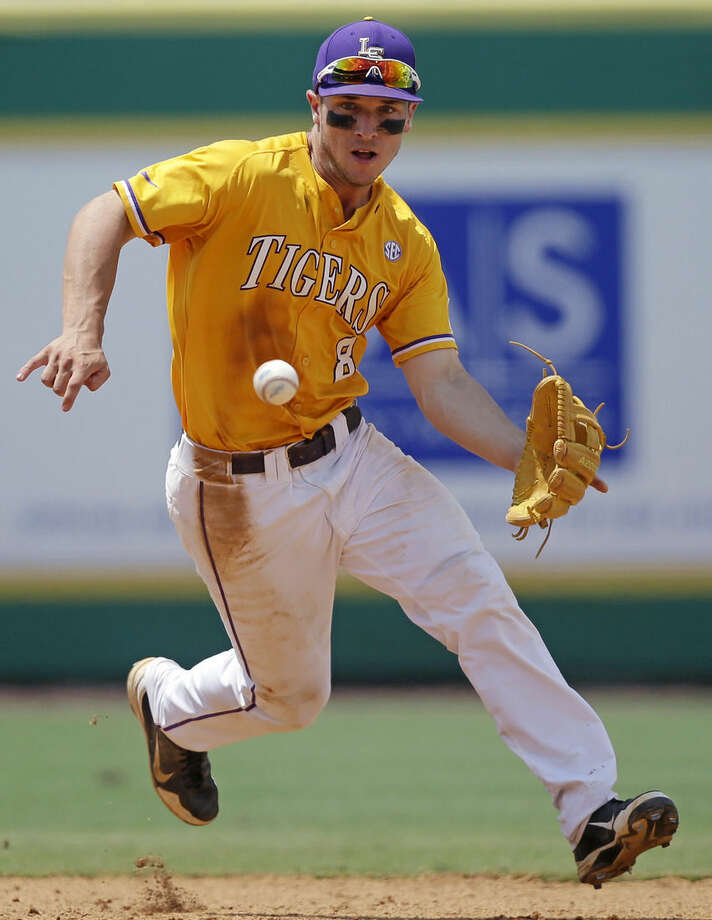FILE - In this Monday, June 1, 2015, file photo, LSU infielder Alex Bregman (8) fields a grounder hit by UNC Wilmington's Robbie Thorburn in the eighth inning of an NCAA college baseball tournament regional game in Baton Rouge, La. Bergman is among the top prospects entering the MLB draft. (AP Photo/Gerald Herbert, File)