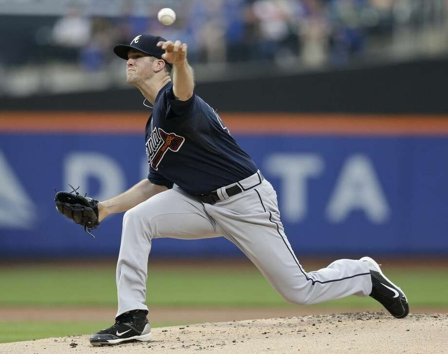 Atlanta Braves' Alex Wood delivers a pitch during the first inning of a baseball game against the New York Mets, Friday, June 12, 2015, in New York. (AP Photo/Frank Franklin II)