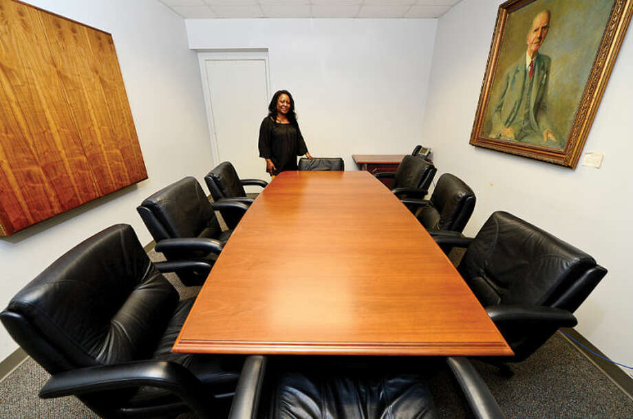 Hour photo / Erik Trautmann Sally Johnson, Executive Assistant to the Mayorof Norwalk, shows off the office furniture that Northrop Grumman donated to the city from their former Norwalk facilty.