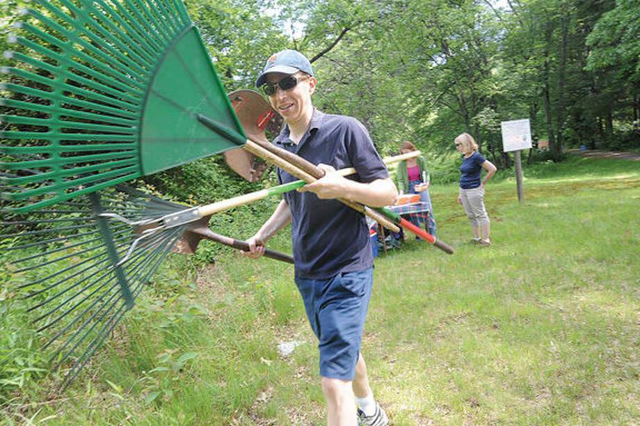 Bob Welsh, member of Save Cranbury, Again and with Board of Directors of the Norwalk Landtrust takes part in the cleanup of the White Barn Preserve along with members of The Westport RTM and Save Westport Now on Saturday. Hour photo/Matthew Vinci