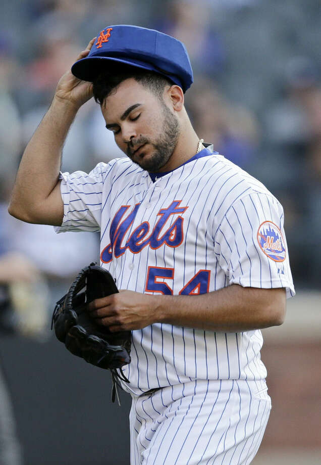 New York Mets' Alex Torres (54) reacts as he leaves the field during the ninth inning of a baseball game against the Atlanta Braves Saturday, June 13, 2015, in New York. (AP Photo/Frank Franklin II)