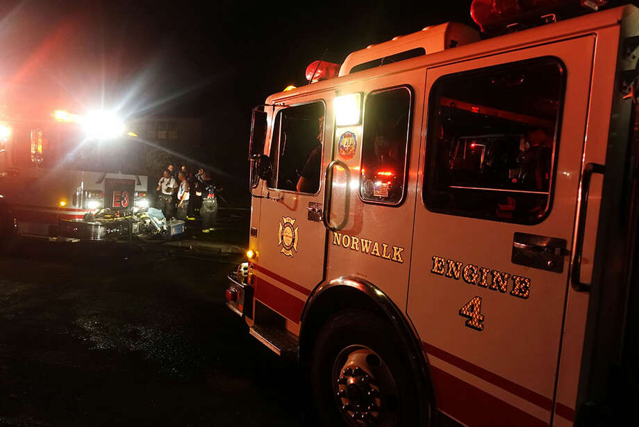Hour photo/Jeff DaleA fire at 8 Lighthouse Lane in Norwalk Friday night displaced a family of three and their pet bulldog Rex.
