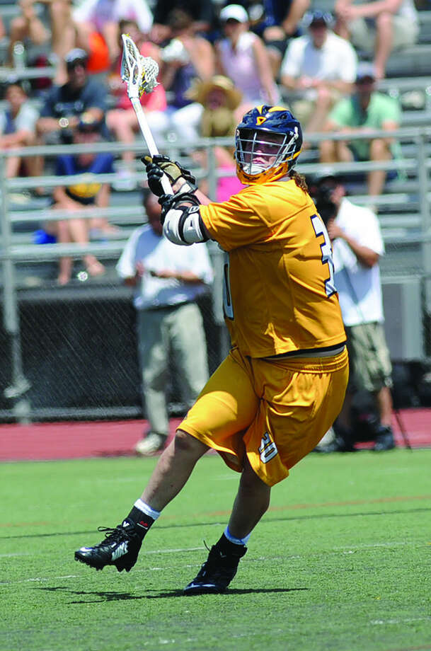 Alex Crowell scores on of two goals Weston boys lacrosse Saturday. Hour photo/Matthew Vinci