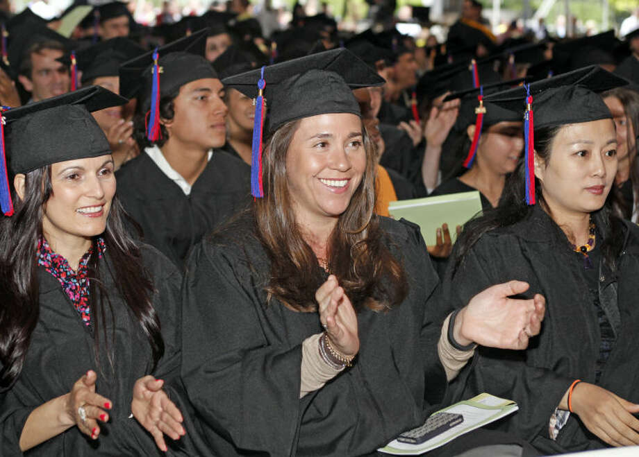 Vanessa Scialpi applaudes durng the 52nd Annual Commencement Excercise at Norwalk Community College Thursday afternoon. Hour Photo / Danielle Calloway