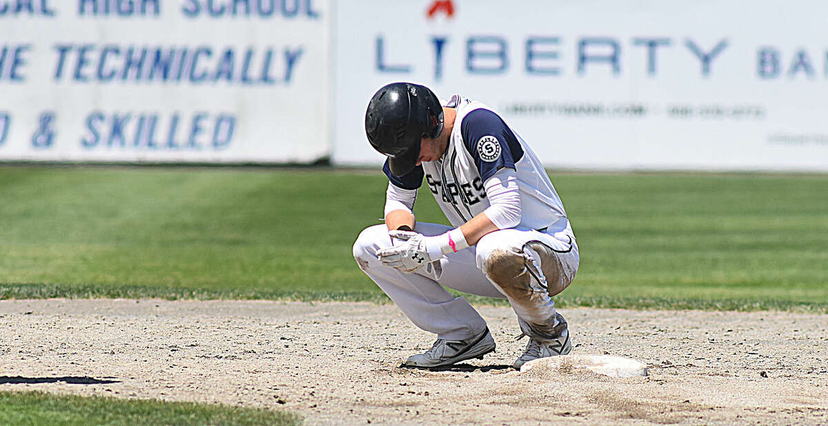 Hour photo/John Nash - Staples' Nate Panzer reacts after getting forced out at second on a rally-ending double play in the bottom of the sixth inning.