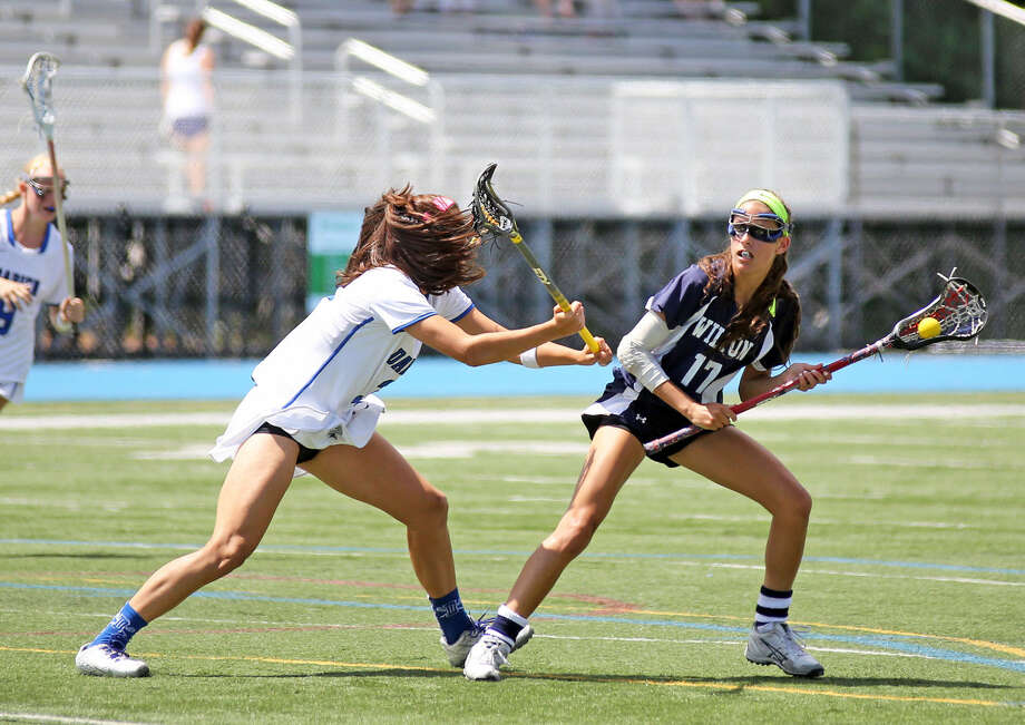Wilton's #17, Laine Parsons, prepares to make a pass during the Girls Lacrosse State Final at Bunnell High School in Stratford Saturday morning. Hour Photo / Danielle Calloway