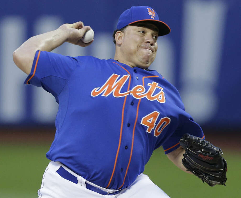 New York Mets starting pitcher Bartolo Colon delivers against the Arizona Diamondbacks during the first inning of a baseball game, Friday, May 23, 2014, in New York. (AP Photo/Julie Jacobson)