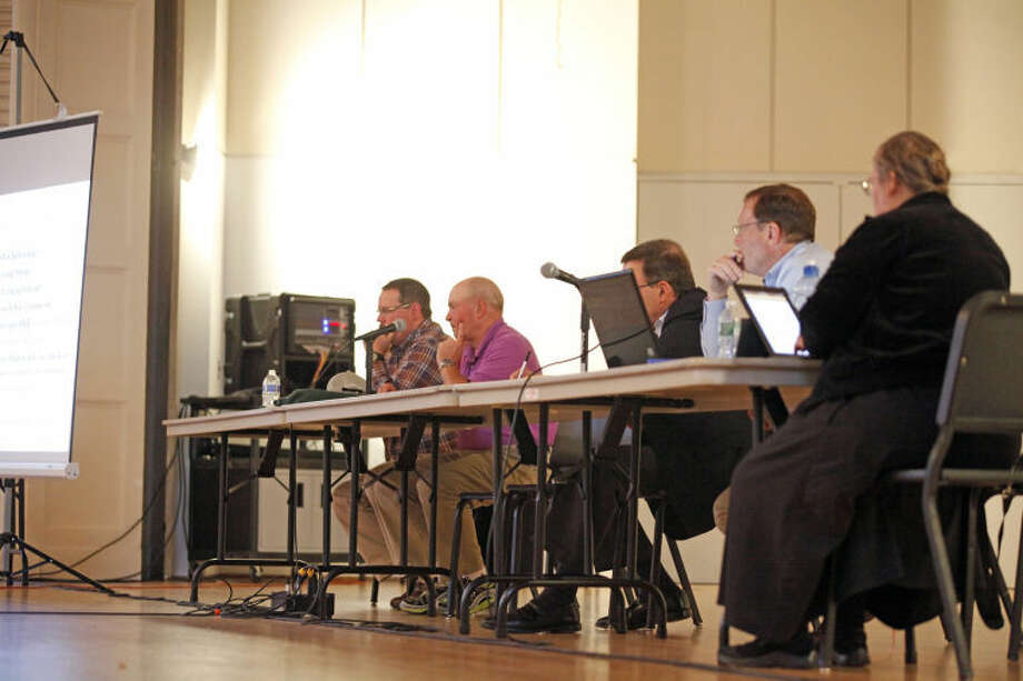 A panel listens to speakers at a public hearing held by The Oak Hills Park Authority on the master plan for Oak Hills Park on Thursday evening at Norwalk Concert Hall. Hour Photo / Danielle Calloway