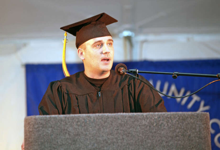 Bryan Stascavage speaks durng the 52nd Annual Commencement Excercise at Norwalk Community College Thursday afternoon. Hour Photo / Danielle Calloway