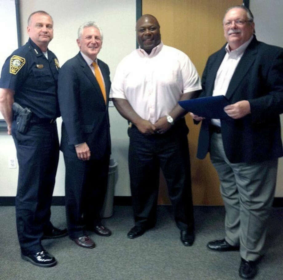 Contributed photoFrom left to right, Police Chief Thomas Kulhawik, Mayor Harry Rilling, Detective Mark Edwards and Police Commissioner Charlie Yost at the Officer of the Month ceremony Tuesday.