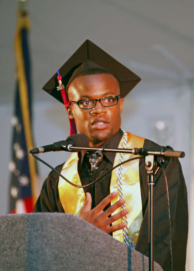 Ralph White speaks durng the 52nd Annual Commencement Excercise at Norwalk Community College Thursday afternoon. Hour Photo / Danielle Calloway