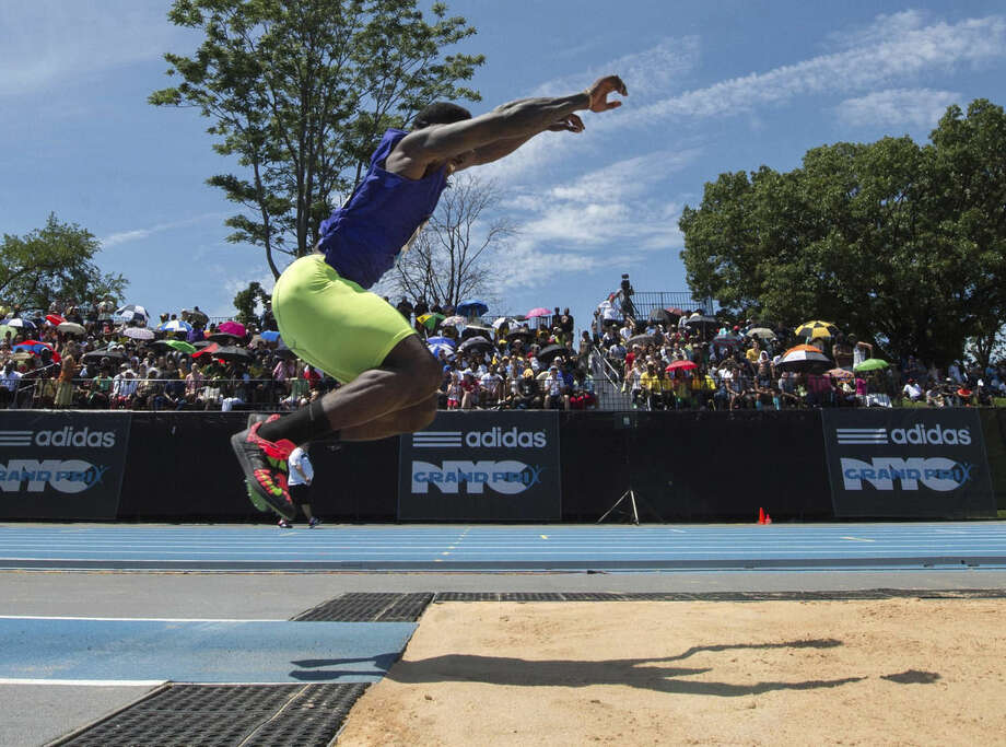 Former NY Giant David Wilson competes in the triple jump at the Adidas Grand Prix, Saturday, June 13, 2015, in New York. (AP Photo/Bryan R, Smith)