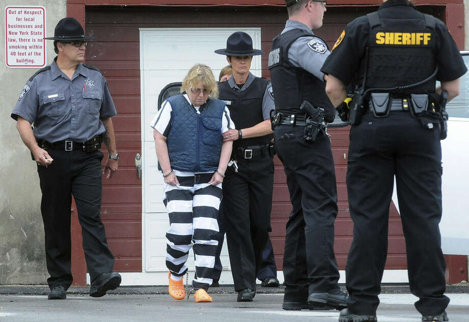 Joyce Mitchell leaves Plattsburgh City Court after her hearing, Monday, June 15, 2015, in Plattsburgh, N.Y. Mitchell is charged with helping convicted murderers Richard Matt and David Sweat escape from Clinton Correctional Facility. (Rob Fountain/Press-Republican via AP)