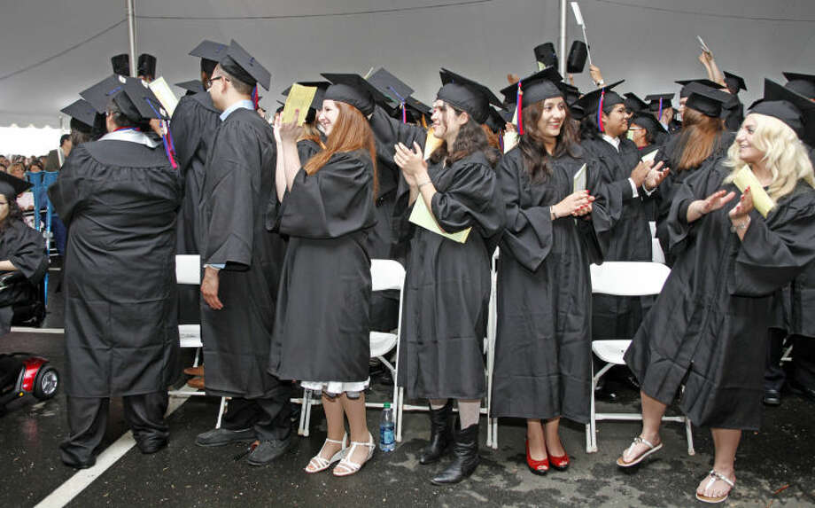 Graduates applaude durng the 52nd Annual Commencement Excercise at Norwalk Community College Thursday afternoon. Hour Photo / Danielle Calloway