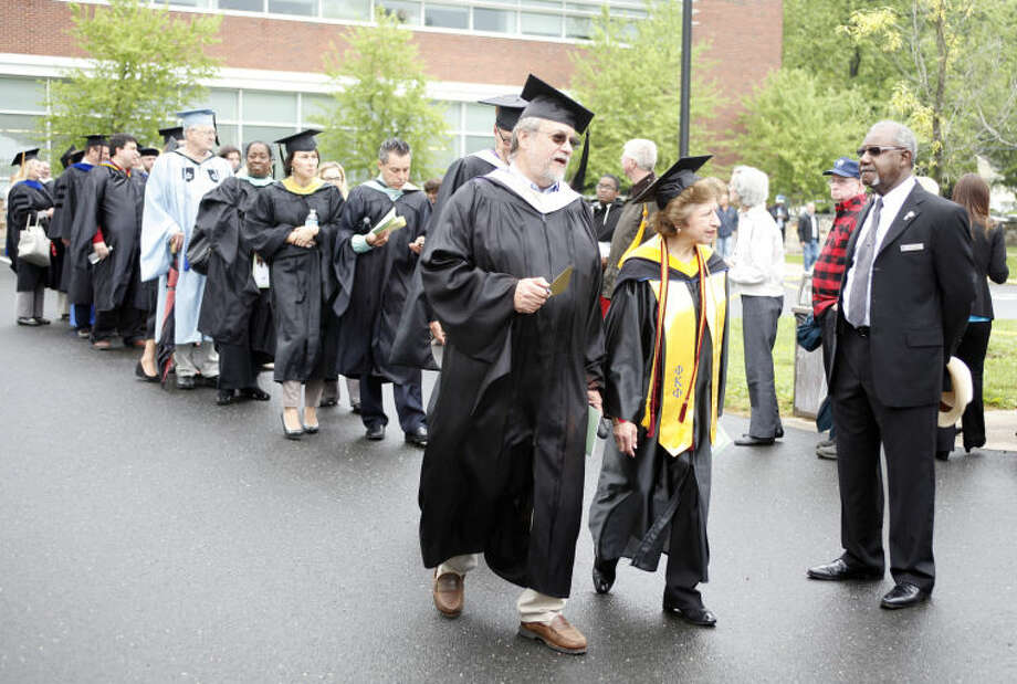 Staff members enter the ceremony durng the 52nd Annual Commencement Excercise at Norwalk Community College Thursday afternoon. Hour Photo / Danielle Calloway