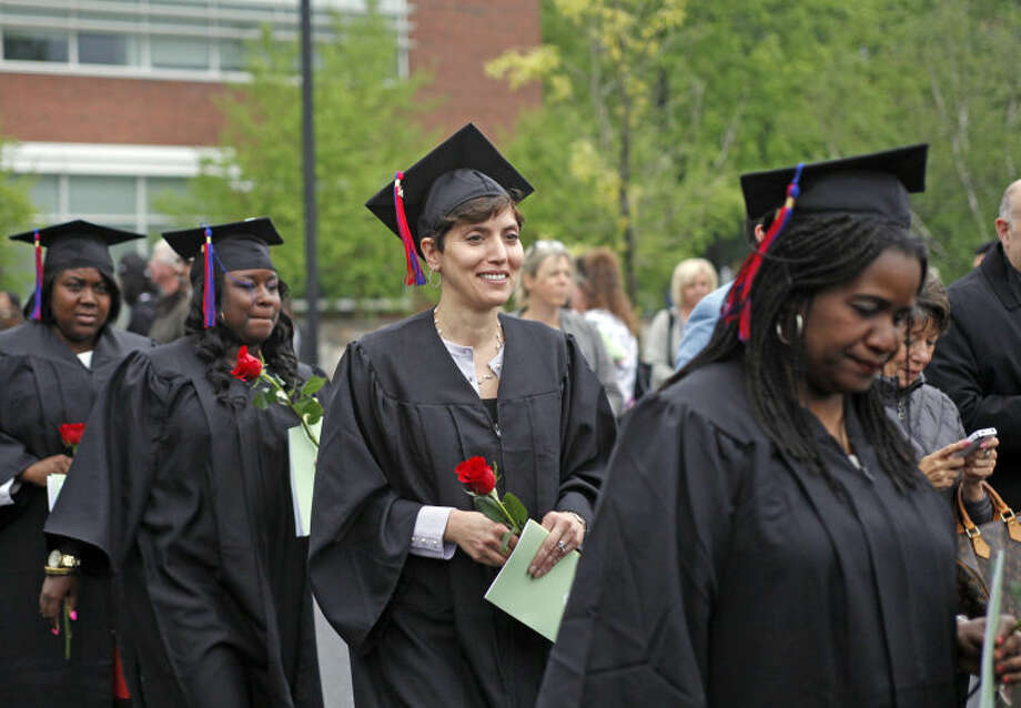 Graduates enter the ceremony durng the 52nd Annual Commencement Excercise at Norwalk Community College Thursday afternoon. Hour Photo / Danielle Calloway