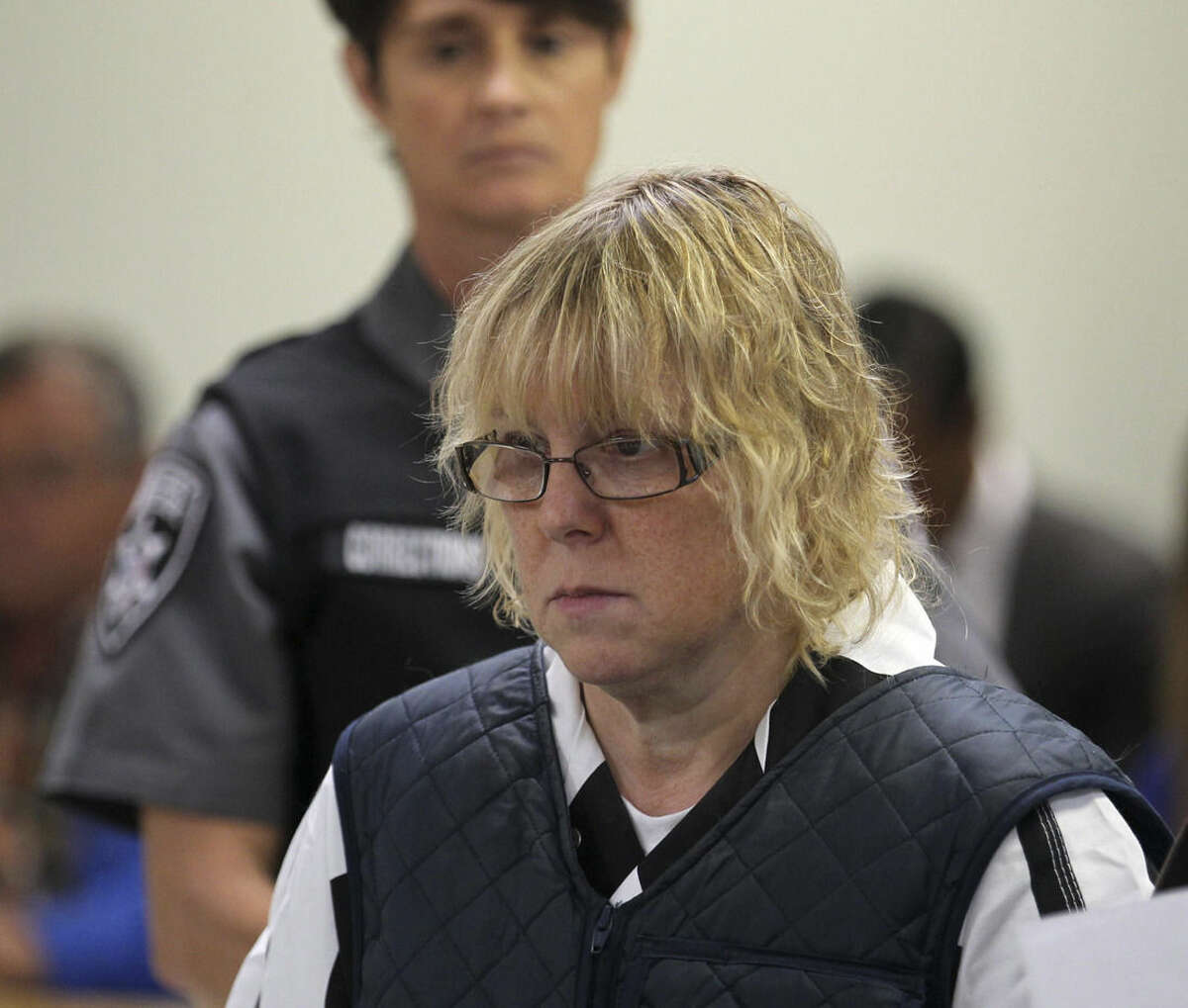 FILE - In this June 15, 2015, file photo, Joyce Mitchell appears before Judge Mark Rogers in Plattsburgh (N.Y.) City Court for a hearing. She is charged with helping Richard Matt and David Sweat escape from the Clinton Correctional Facility on June 6. While Richard Matt and David Sweat counted their final hours to freedom, prison tailor-shop instructor Mitchell was heading to a hospital with chest pains driven by a panic attack. She was leaving the hospital when she learned that Matt and Sweat were on the loose and that state police were looking for her and her husband, Lyle, a fellow industrial instructor at the prison. (G.N. Miller/NY Post via AP, Pool, File)