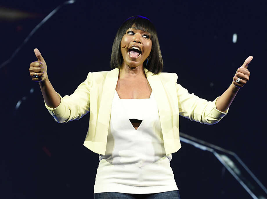 """Cast member Angela Bassett addresses the audience during the """"Tom Clancy's Rainbow Six Siege"""" game segment at Ubisoft's E3 2015 Conference at the Orpheum Theatre on Monday, June 15, 2015, in Los Angeles. (Photo by Chris Pizzello/Invision/AP)"""